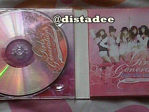 Isi 2 CD dan photobook